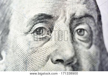 Benjamin Franklin face on USA one hundred dollar bill macro close up