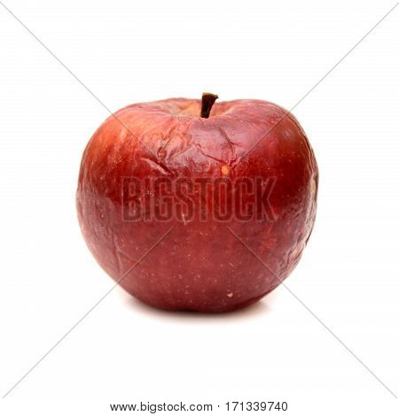 Red rotten apple isolated, natural color and texture