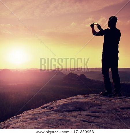 Sportsman Take Selfie Photo With Phone At Mountain Peak.