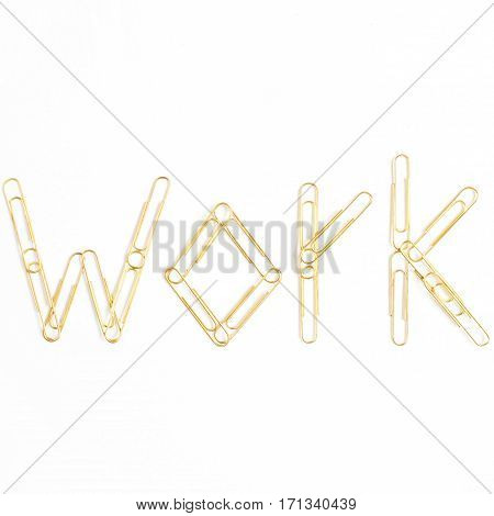 Word Work made of golden clips. Minimalistic flat lay top view composition.