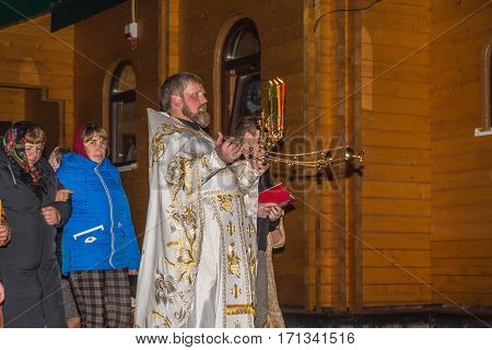 Dobrush, Belarus - May 1, 2016: Religious procession around the temple. Happy Easter ritual