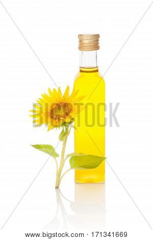 Sunflower oil and sunflower blossom isolated on white background.