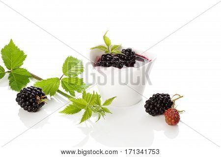 Blackberry yogurt with fresh berries isolated on white background. Fresh healthy dessert.