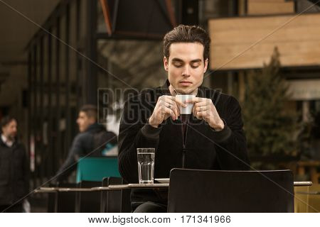 Young Man Drinking, Coffee Cup, Outdoors Passersby