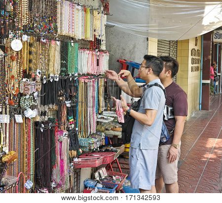 BANGKOK, THAILAND-FEBRUARY 04,2017 : People choose to purchase the necklace at the market of Sempeng Chinatown on Bangkok, Thailand