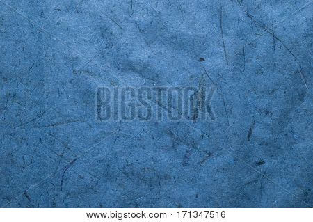 Abstract blue background. Blue texture. Close up view of plant fiber texture. Abstract blue background and texture for designers. Plant fiber background.