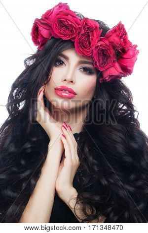 Nice Brunette Model Woman with Long Healthy Hair Wearing Pink Summer Wreath. Makeup Hairstyle Manicure Rose Flowers
