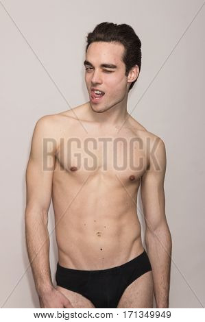 Young Man Shirtless Body Slim Fit Winking, Tongue Out