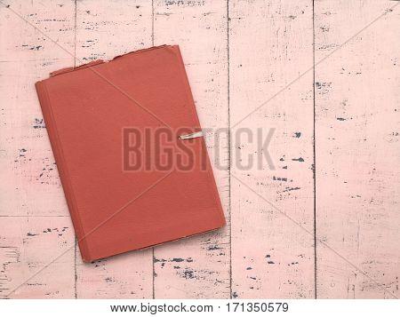 retro folder on old pink wooden background