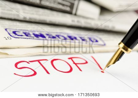 Censored stamped on a newspaper and stop written with a fountain pen.