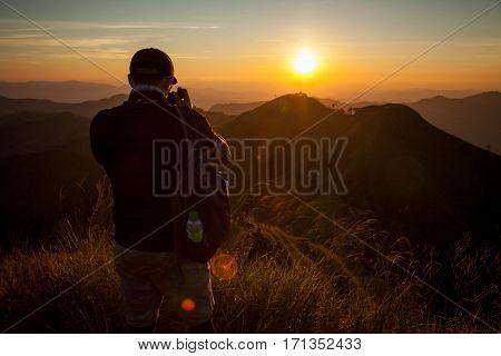 Traveler Look At Sunset