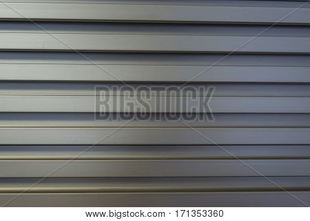 Ribbed or corrugated cast silver metal modern surface