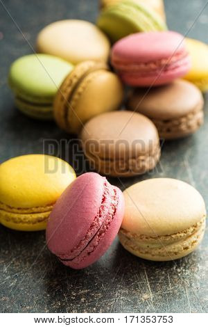 Tasty sweet macarons. Macaroons on old table.