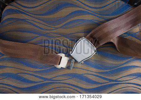 Unfasten safety belt on chair of airplane