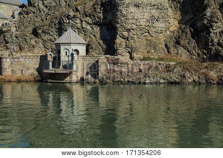 Shrine as part of Metekhi Church of Assumption on bank of Kura river in Tbilisi, Georgia