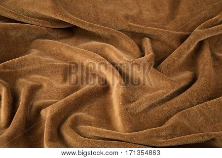 brown silk velvet close-up. Fabric macro for texture and background