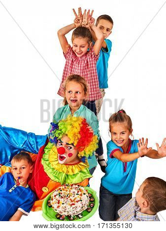 Birthday child clown playing with children. Kid holiday cakes celebratory in hands of events organizer man. Children give someone bunny ears . Fun of group people lying floor on white background.