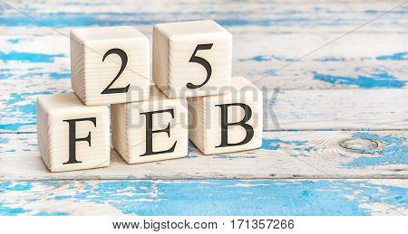 February 25Th. Wooden Cubes With Date Of 25 February On Old Blue Wooden Background.