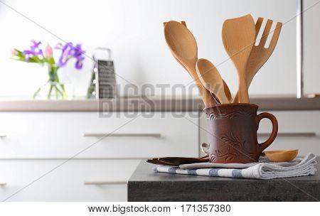 Wooden cooking utensils at kitchen