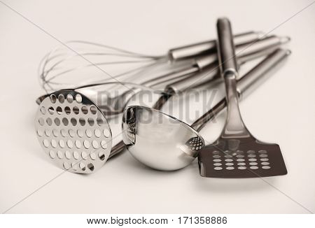 Set of metal kitchen utensils on table