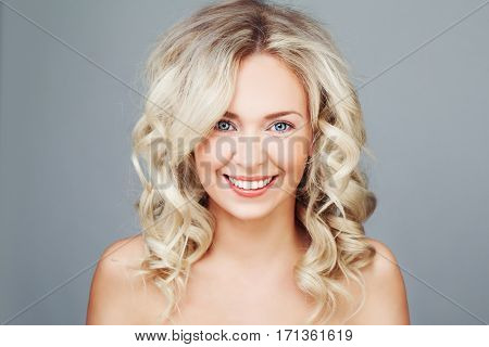 Young Blonde Woman with Curly Hair Smiling. Happy Fashion Model Close up