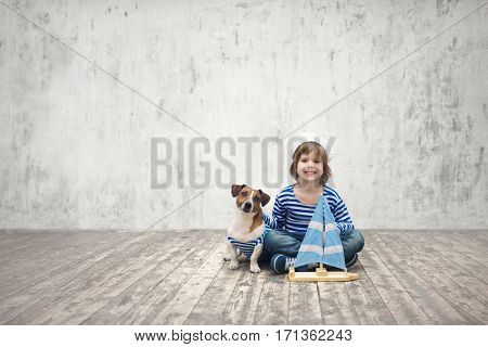 Little sailor with dog indoors