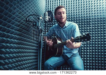 Young man in a recording studio