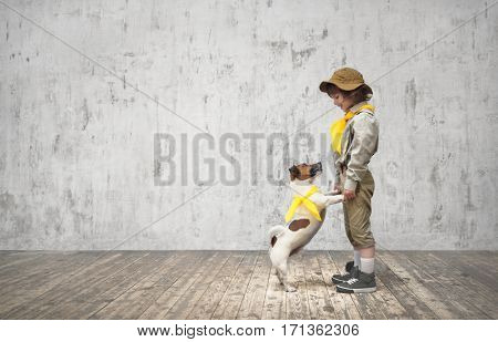 Little boy in uniform with dog