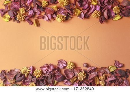 Dried flowers composition on colorful background. Frame made of dried flowers and leaves. Top view, flat lay. Copy space for text