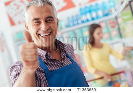 Supermarket Clerk Giving A Thumbs Up