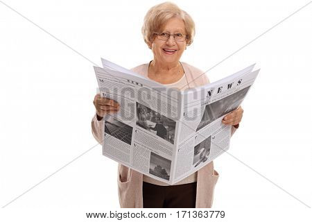 Mature woman holding a newspaper and looking at the camera isolated on white background