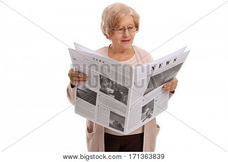 Mature woman reading a newspaper isolated on white background