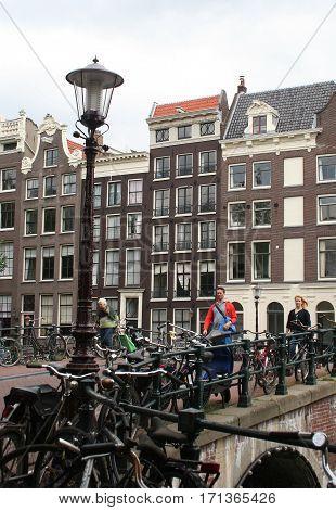 Netherlands Amsterdam June 2016: Bikes ar parking on a bridge over the Keizersgracht