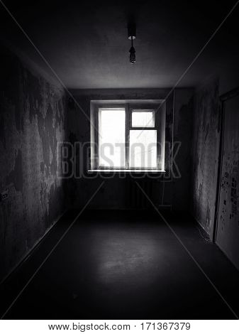 Empty abandoned room. Haunted house. Creepy dark room