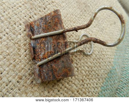 Rusty paper clip placed on the sack.