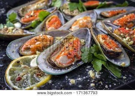 Baked Green Shell Mussels on old rustic Sheet