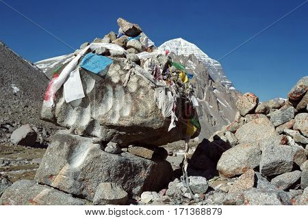Sacred stones with recesses wiped by prayer beads of many pilgrims who went the ritual route around Holy Mount Kailash in Western Tibet.