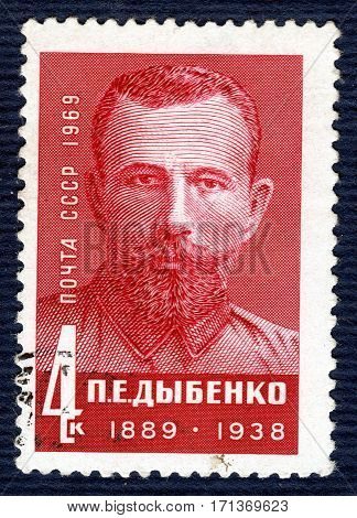 USSR - CIRCA 1969: Postage stamp printed in USSR with a portrait of P. E. Dybenko (1889-1938),Soviet military leader, from the series