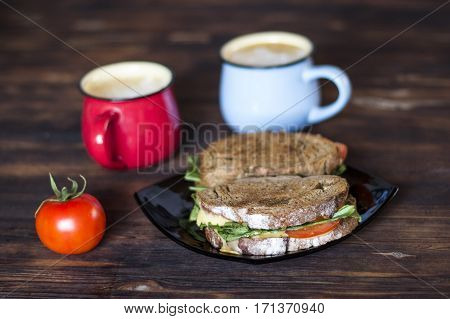 Breakfast. Whole wheat Sandwiches and coffee for two on wooden table