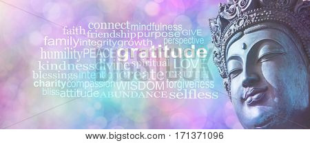 Gratitude Buddhism Word Cloud Banner - Close up of blue grunge style Buddha head on wide pink blue bokeh background with a GRATITUDE word cloud on left side
