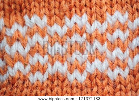 Orange texture with white inserts knitted fabric for the background