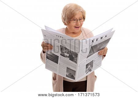 Surprised elderly woman reading a newspaper isolated on white background