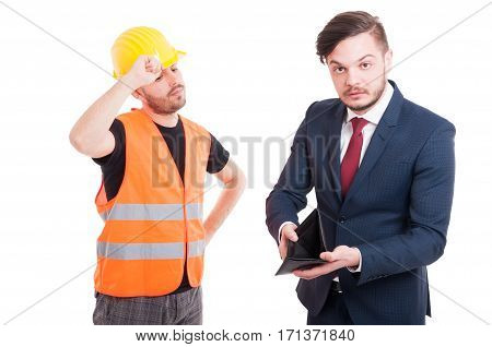 Financial Problems Concept With Young Builder And Businessman