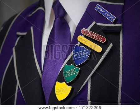 School boys blazer with multiple school badges