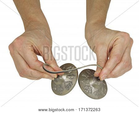 Holding Tibetan Ting Sha Ceremonial Bells - female hands holding a pair of Ting Sha percussion bells isolated on a white background