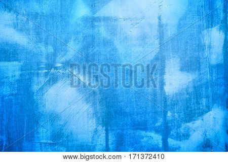 Blue texture of plaster on the wall for the background and space for text