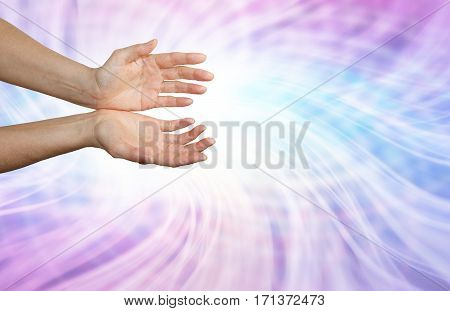 Matrix Energy Field - Female hands held palms up in a pink and blue flowing matrix energy field with plenty of copy space