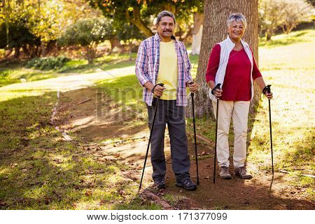 Mature couple going hiking in a park