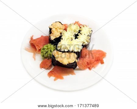 Appetizing sushi pieces on white plate isolated top view closeup