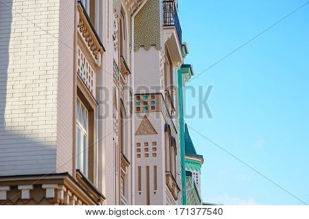 ancient architectural building with balconies in the city street